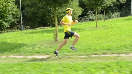 man sports - running - park (trees and grass) - steadicam