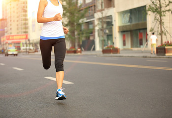 Runner athlete running on city road
