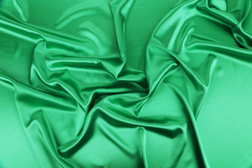 Shiny green silk background.