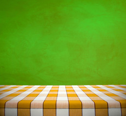 Yellow Tablecloth on Green Wall