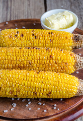 Grilled corn on the wooden board