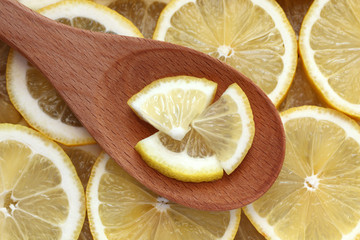 Lemon slices in a wooden spoon