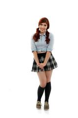 Cute school girl in plaid uniform posing on white background
