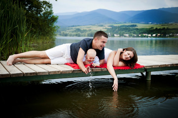 Family with baby on boat
