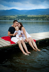 Family with baby on pier