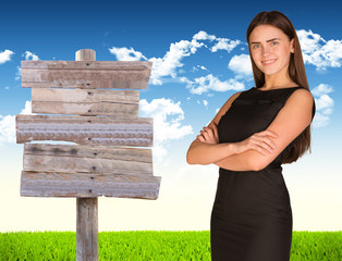 Businesswoman with road sign