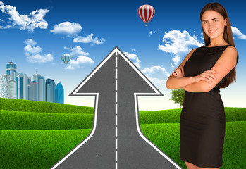 Businesswoman with road climbs up