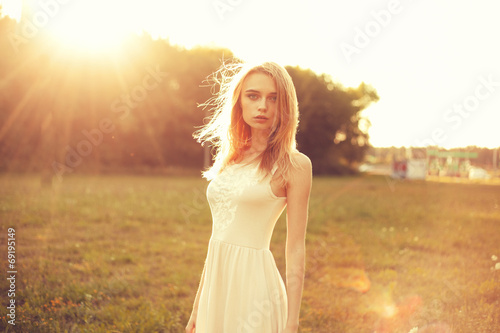 canvas print picture Girl in the park in a white dress on a sunny day