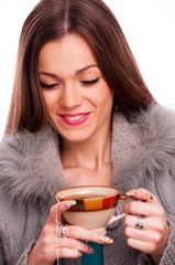 Brunette holding cup of tea
