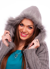 Beautiful brunette in the gray sweater with hood