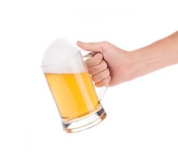 Hand holding glass full of beer.