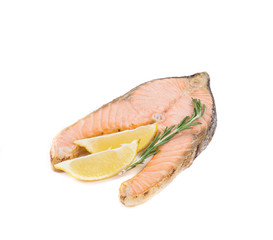 Fried salmon fillet with lemon and rosemary.