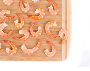 Tasty boiled shrimps on cutting board.