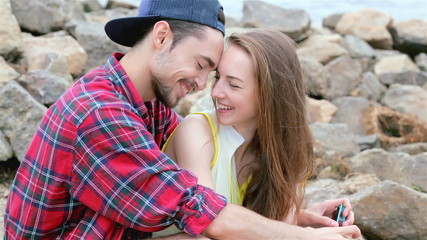 Cheerful couple in love. Tenderness touch foreheads.