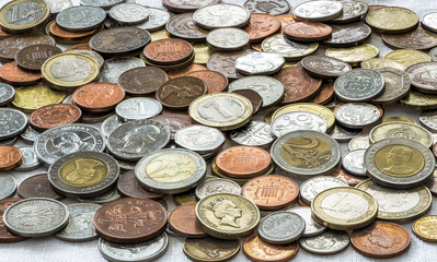 Variety of coins from differnt countries, background closeup