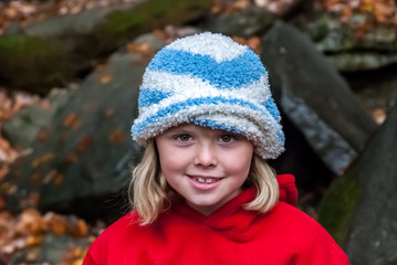 Young Girl Wearing Hat Looks at Camera
