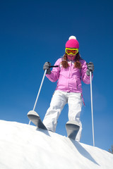 girl on mountain skiing
