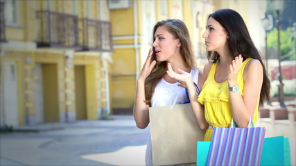 Two girls standing in front of a showcase discuss new dress