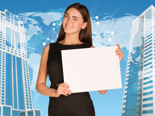Businesswoman with world map and skyscrapers