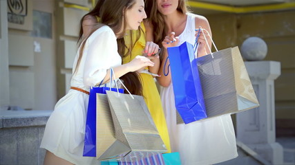 The girls look at packages with fashionable things and decide