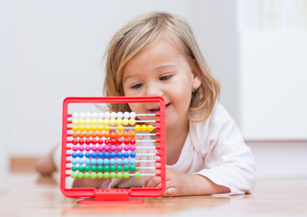 Little girl learning with abacus