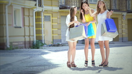 Shopaholic girls looking at shopping and then start to go merril
