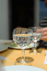 Sparkling water in glass on the table