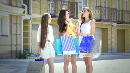 girls discuss new purchases on a sunny afternoon