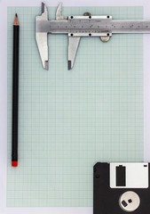 Graph paper A4 with pencil, floppy disk and vernier caliper
