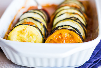 hot  ratatouille in a baking dish on a white background