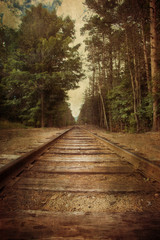 Old railroad tracks with vintage texture effect