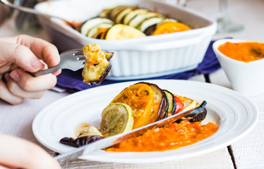 processes to eat vegetable ratatouille with a fork and knife, ha