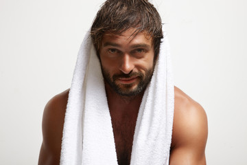 smiling man with a towel after bath