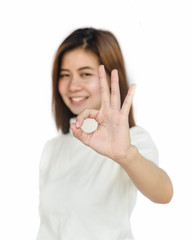Asian woman showing hand sign .