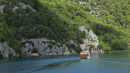 Shot of the boat passing by on the Krka river-Croatia