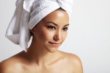 beauty woman with a towel on her head