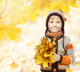 autumn kid in leaves, little child in woolen hat