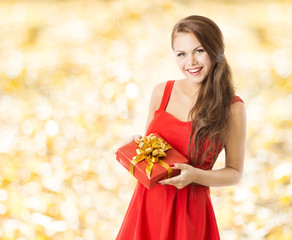 autumn present gift box, smiling woman holding presents