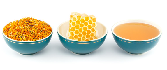Honey, honeycomb and pollen in bowls