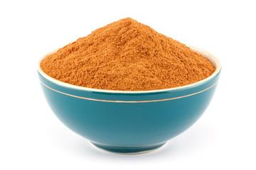 Ground cinnamon in bowl