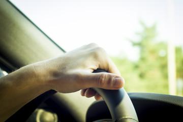 holding steering wheel