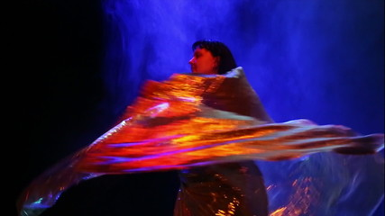 woman in east dancing suit with golden wings