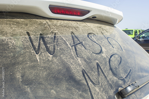 canvas print picture Dirty rear window of the car and inscription Wash me