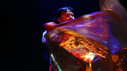 woman dancing with golden wings