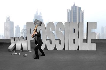 businessman hold sledgehammer to smash impossible 3D concrete wo
