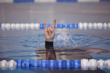 diving command hand on the water surface