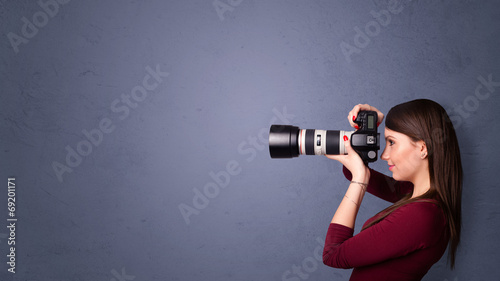 Photographer shooting images with copyspace area - 69201171
