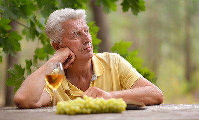 Mature man with glass of wine