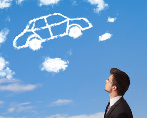 Handsome young man looking at car cloud on a blue sky