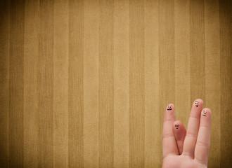 Happy finger smileys with vintage stripe wallpaper background